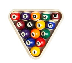 Photo of macro balls with billiard highlights with numbers and different colors in a plastic triangle. Top view close-up