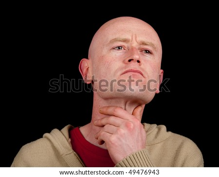 photo of male holding is throat on black backdrop