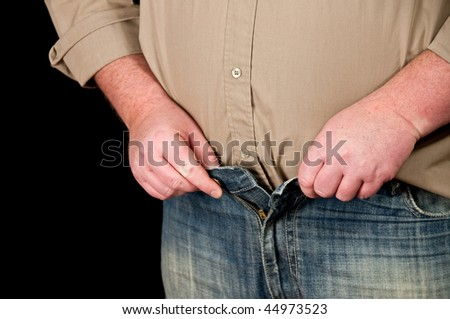photo of male in jeans open waistline on black background