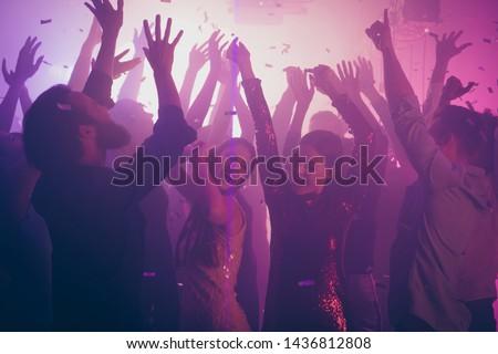 Photo of many birthday amazing people dancing students life purple lights confetti flying nightclub hands raised shiny formal-wear