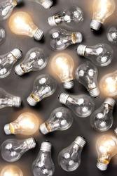 photo of many light bulbs lying on black background