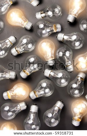 photo of many light bulbs lying on black background