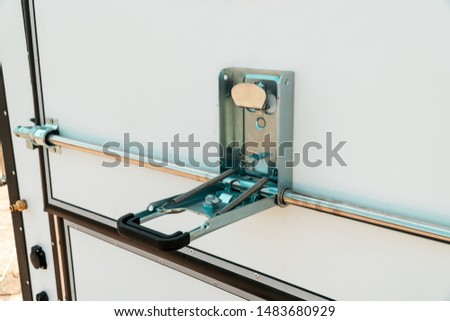 Photo of metal chromeplated  the lock on a white door of the van close up #1483680929
