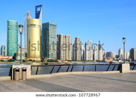 Photo of modern buildings by Huangpu river at Pudong Lujiazui Skyline Shanghai, China