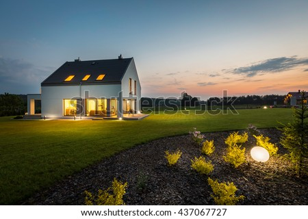 Photo of modern house with outdoor lighting, at night, external view #437067727