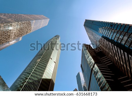 Photo of modern towers of skyscrapers illuminated by the sun #631668173