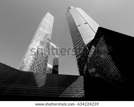 Photo of modern towers of skyscrapers illuminated by the sun #634224239