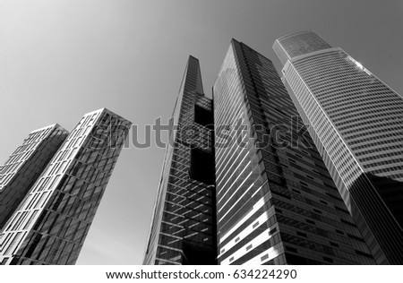 Photo of modern towers of skyscrapers illuminated by the sun #634224290