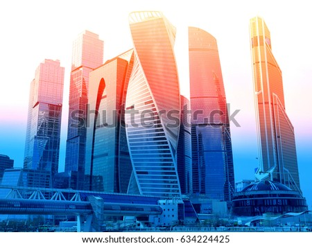Photo of modern towers of skyscrapers illuminated by the sun #634224425