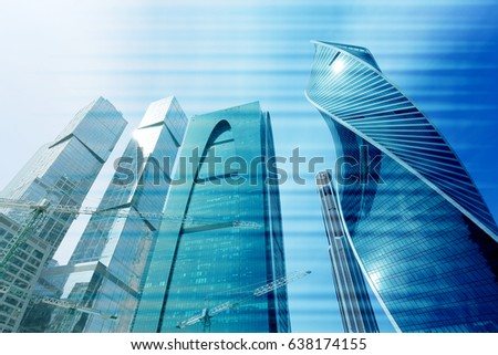 Photo of modern towers of skyscrapers illuminated by the sun #638174155