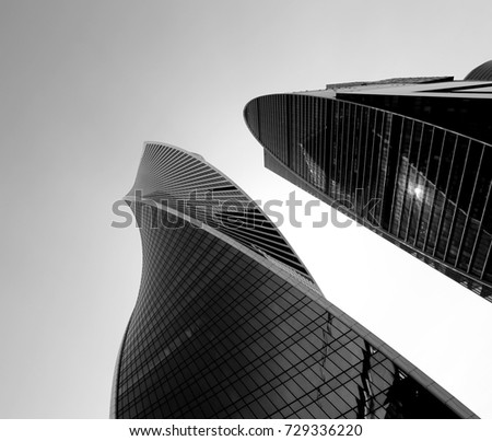 Photo of modern towers of skyscrapers illuminated by the sun #729336220