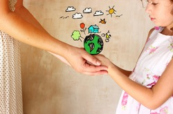 photo of mother and child holding hands and showing a better world concept with set infographics . protection and education concept