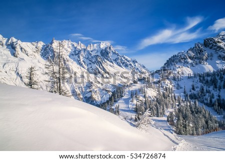 Photo of mountains and peaks covered in snow in Courmayeur in northern Italy.