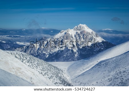 Photo of mountains covered in snow during winter in High Tatras in Slovakia.