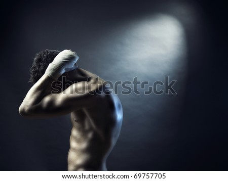 Photo of naked athlete with strong body