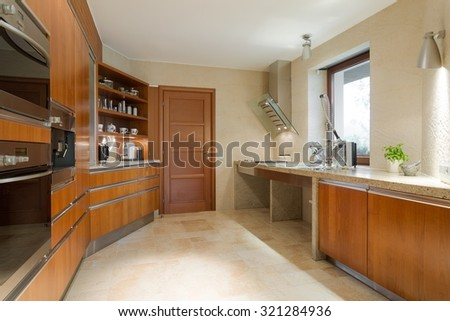 Photo of new designed spacious wooden kitchen