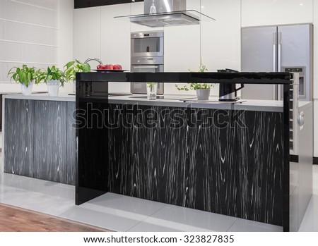 Photo of new kitchen with decorative black and white worktop