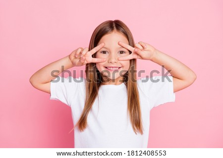 Photo of nice adorable pretty kid enjoy spring free time make v-sign wear good look clothes isolated over pink color background