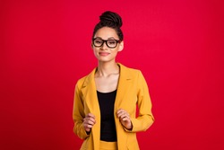 Photo of nice millennial lady touch cardigan wear eyewear isolated on vivid red color background