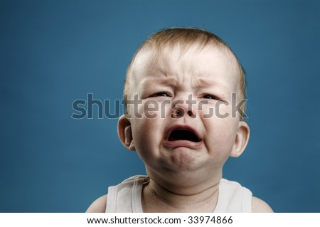 Photo of nine month baby crying isolated
