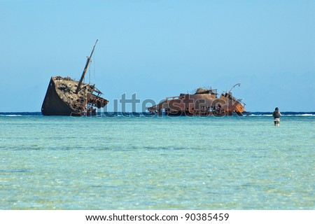 photo of old rusty ship run aground