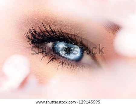 Photo of one beautiful blue female eye, ophthalmology clinic, eyes health care, natural makeup, black mascara, healthy lifestyle, medicine and cosmetics concept
