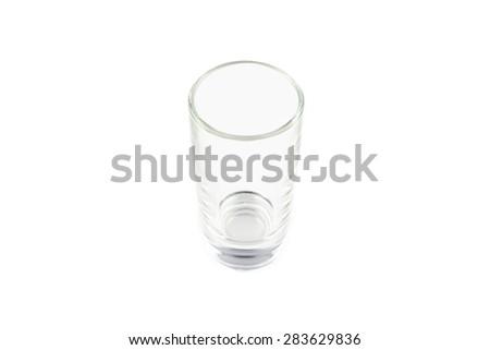 Photo of one empty shot on white background