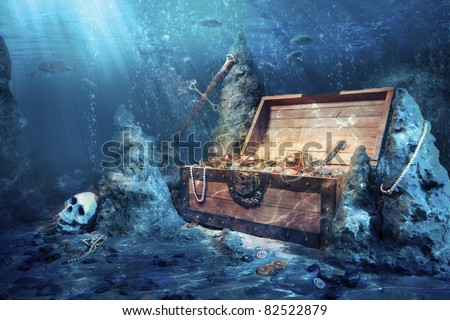 photo of open treasure chest with shinny gold underwater Сток-фото ©