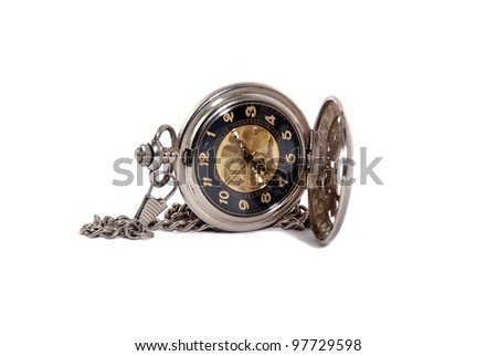 Photo of opened old vintage pocket watch against the white background