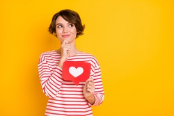 Photo of optimistic brunette lady hold like look empty space wear red shirt isolated on orange color background
