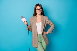 Photo of optimistic brunette lady stand with mic wear spectacles brown jacket isolated on vivid blue background