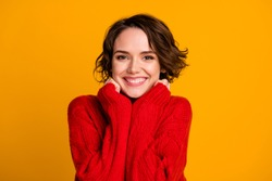 Photo of overjoyed lady good mood enjoy joyful soft cloth laundry warmth toothy smile winter holidays atmosphere wear casual red knitted sweater isolated vivid yellow color background