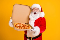Photo of overweight santa claus hold tasty pizza impressed x-mas season shopping pizzeria discount on newyear event wear cap headwear costume isolated over bright shine color background