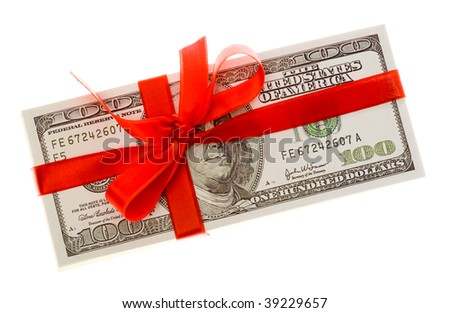 Photo of pack of dollars decorated with red ribbon over white background