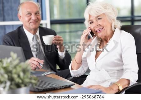 Photo of pair of mature entrepreneurs at work