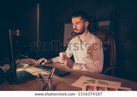 Photo of pensive thoughtful entrepreneur looking pensively into screen in search of new information about increasing income of corporation