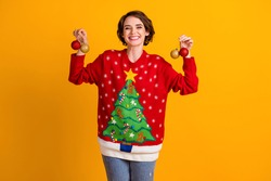 Photo of positive cheerful girl hand christmas tree balls x-mas newyear party, decoration house wear pullover sweater denim jeans isolated over bright shine color background