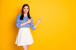 Photo of positive cheerful girl promoter point index finger copyspace demonstrate adverts promotion wear good look white clothes isolated over bright color background