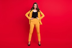 Photo of pretty adorable young woman wear yellow jacket arms waist isolated red color background