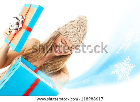 Photo of pretty blond woman in stylish winter hat opened big blue present box, beautiful girl receive Christmas gift, happy young lady holding magic giftbox isolated on white background, New Year eve