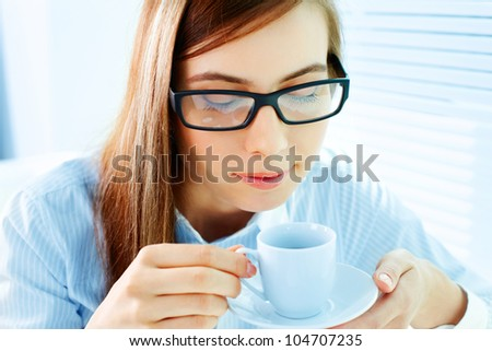 Photo of pretty businesswoman holding porcelain cup with coffee - stock photo