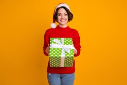 Photo of pretty excited lady winter holidays concept hold big giftbox festive event party x-mas courier delivery wear santa cap red knitted sweater isolated yellow color background