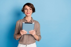 Photo of pretty lady arms hold tablet smile look empty space wear plaid isolate don blue color background