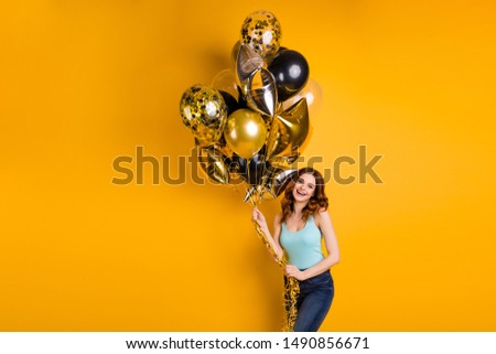 Photo of pretty lady having best bday ever with air ballons in hands wear tank-top isolated yellow background