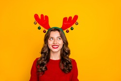 Photo of pretty lady looking on head horns with interest wear knitted jumper isolated yellow background