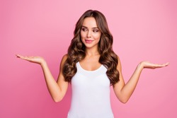 Photo of pretty wavy lady hold new discount price products open palms cool offer demonstrate best option look one arm wear white casual singlet isolated pink color background