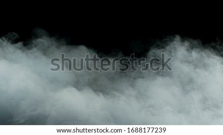 Photo of  Photo of Real Smoke on a black background - realistic overlay for different projects.