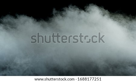 Photo of Real Smoke on a black background - realistic overlay for different projects. stock photo
