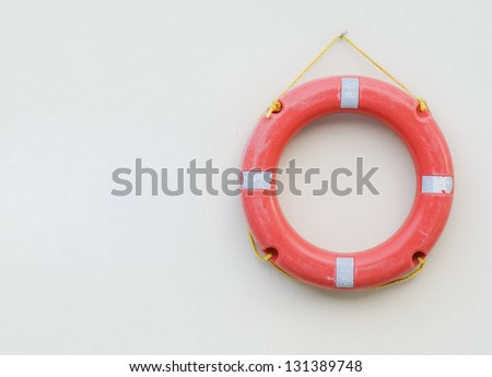 Photo of red buoy hanging on the blank wall