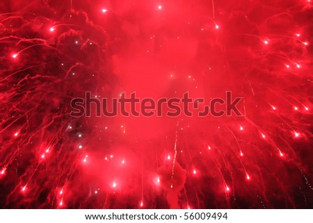Photo of red fireworks in sky at night
